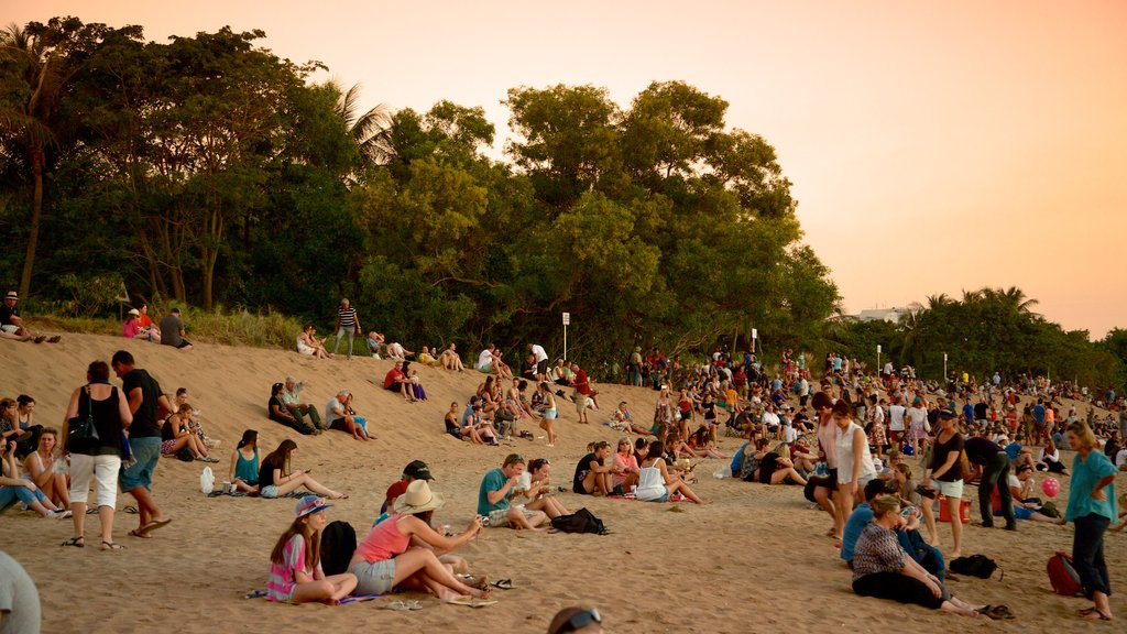 Mindil Beach which includes a sunset and a beach as well as a large group of people