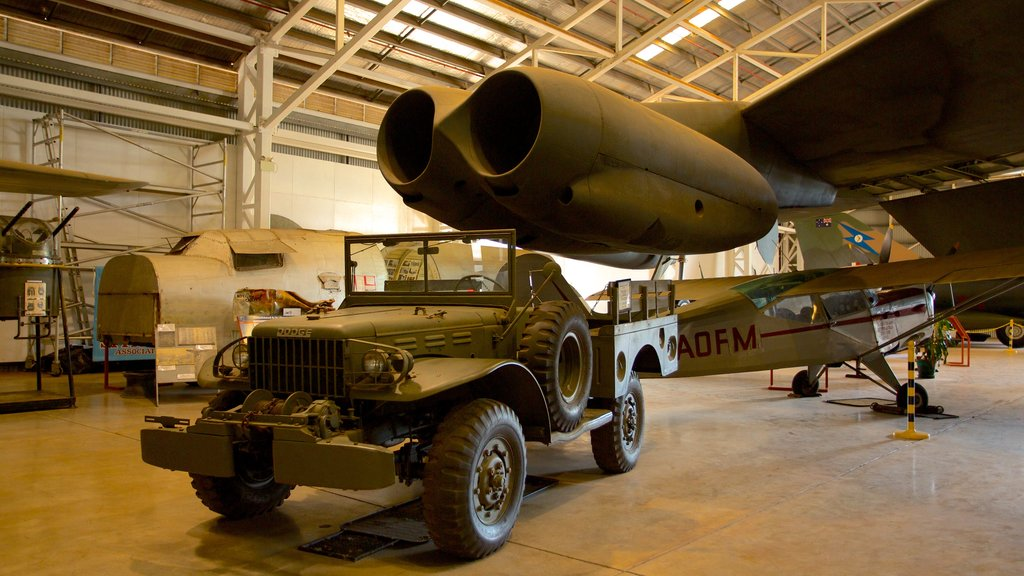 Australian Aviation Heritage Centre which includes interior views, aircraft and military items