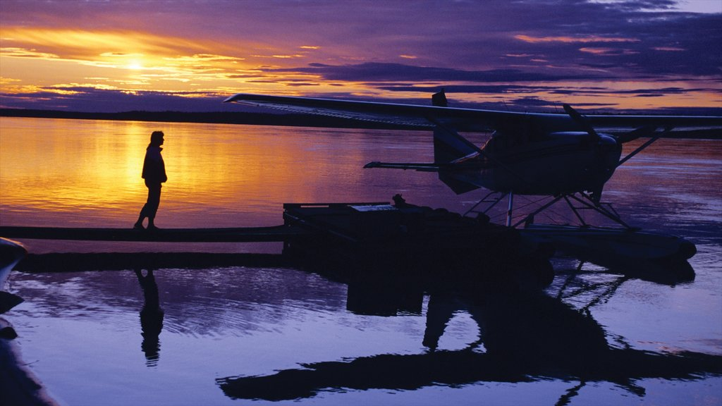 Northwest Territories showing aircraft and a sunset