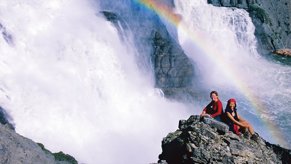 Northwest Territories which includes a waterfall