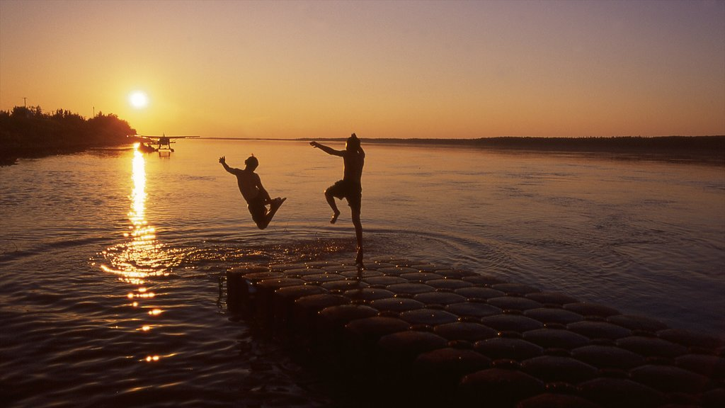 Northwest Territories featuring a sunset and general coastal views