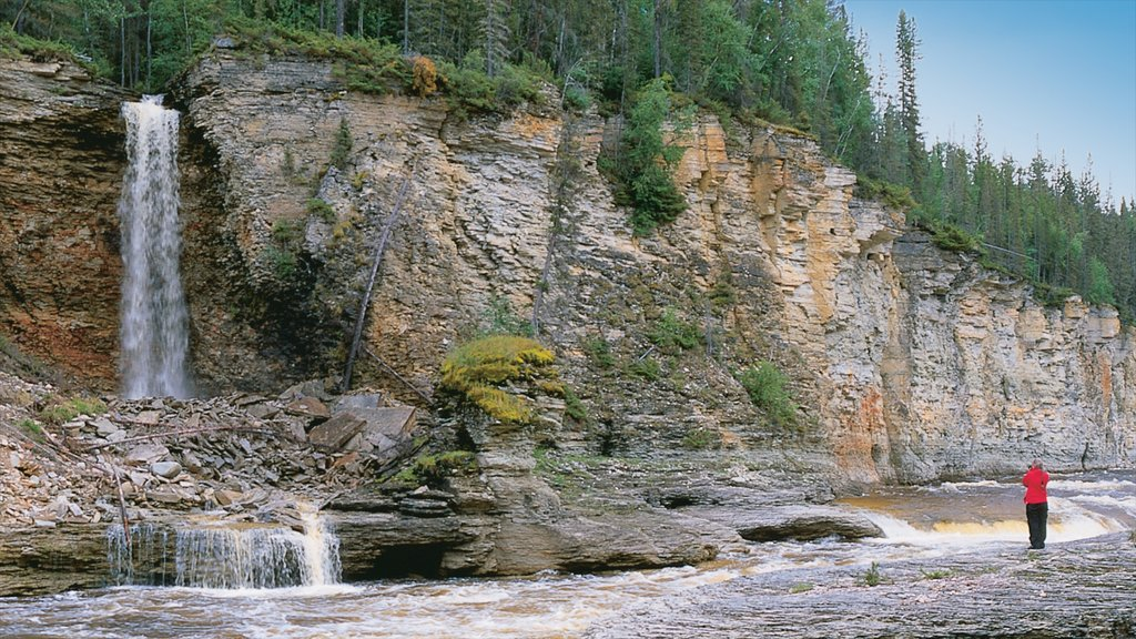 Northwest Territories featuring a river or creek and a waterfall