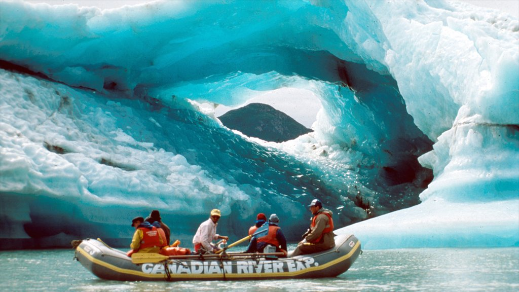 Yukon showing snow and kayaking or canoeing as well as a small group of people