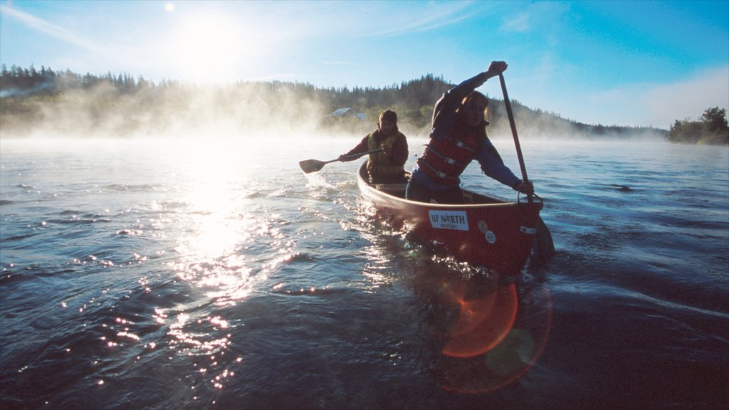 Yukon which includes mist or fog, a lake or waterhole and kayaking or canoeing