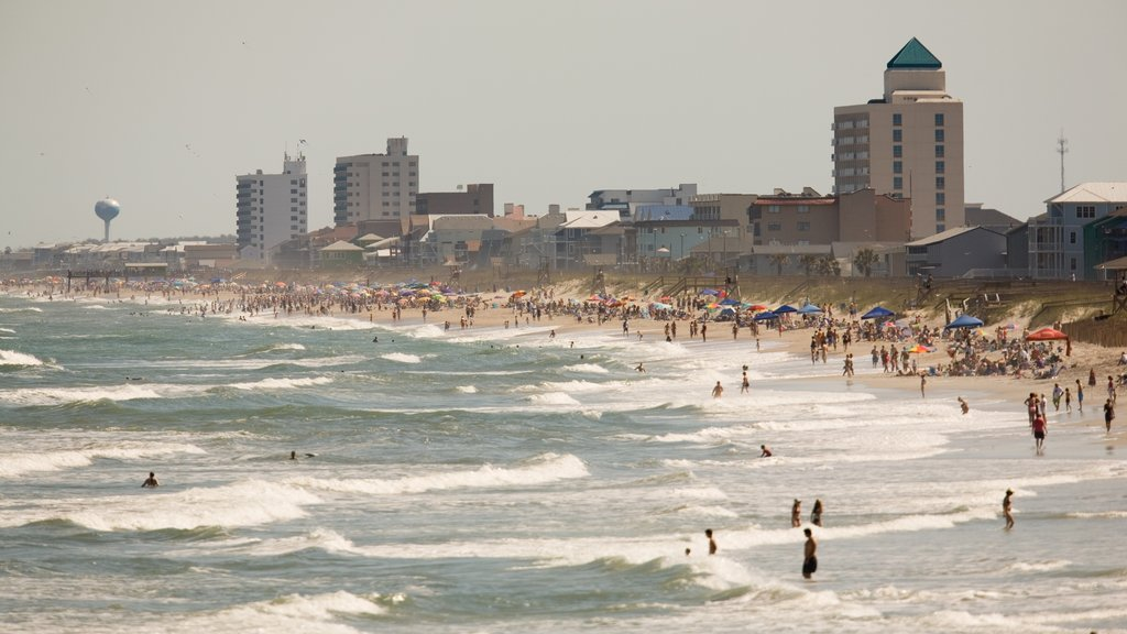 Carolina Beach which includes a beach, surf and a coastal town
