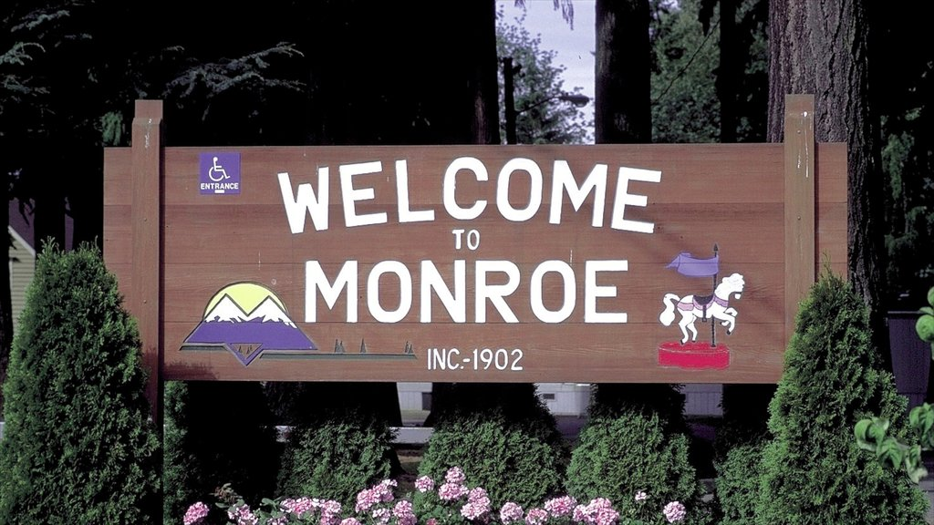 Monroe which includes signage and flowers