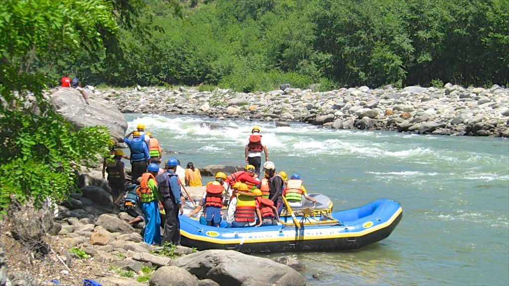 Manali which includes rafting and rapids as well as a large group of people
