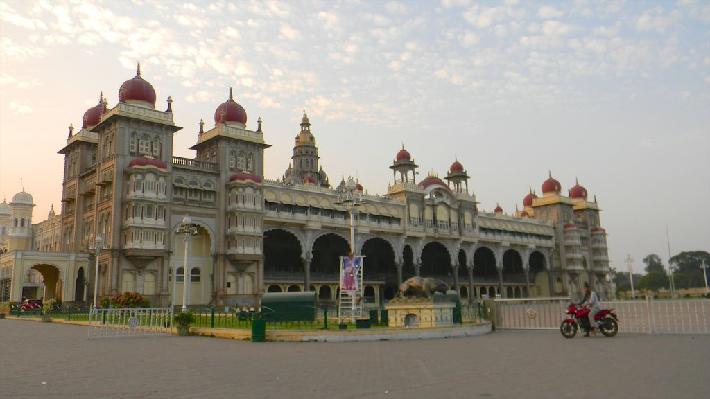 Mysore which includes a castle, heritage architecture and a sunset