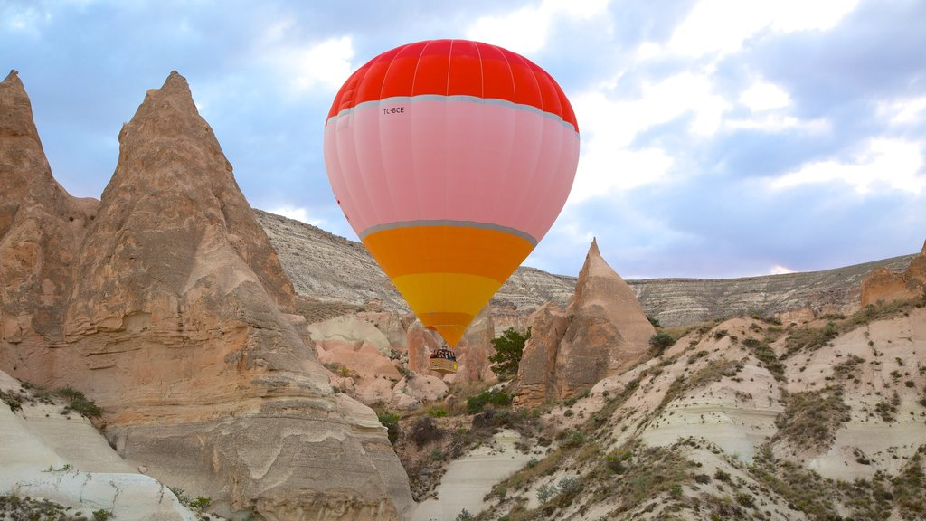 Rose Valley which includes a gorge or canyon, mountains and ballooning