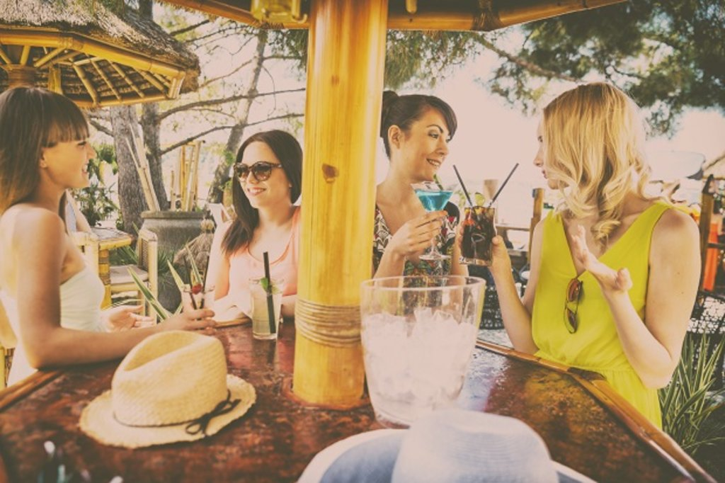 Girls enjoying a cocktail in the sun