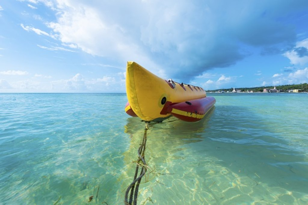 A banana boat in turquoise waters