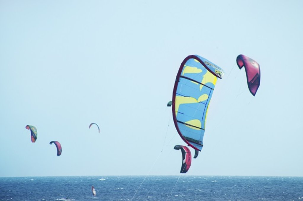 Kite surfing with an ocean background