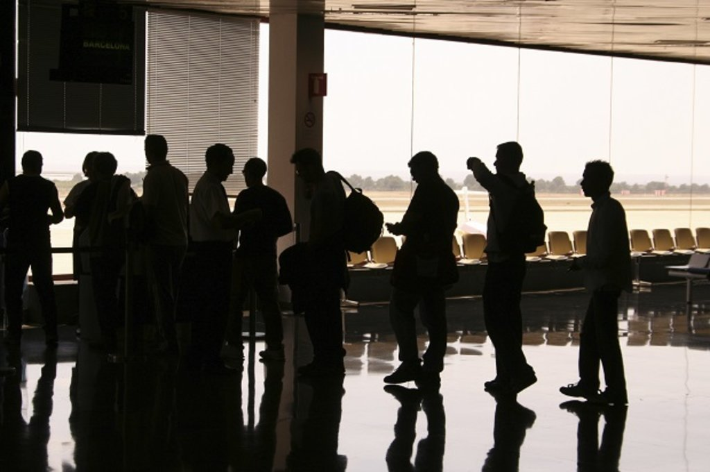 Group of people queuing for flight
