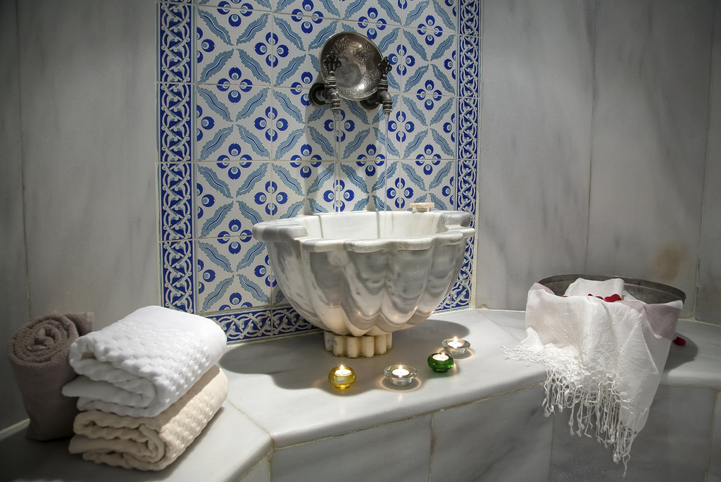 Turkish sink with blue tiles and towels