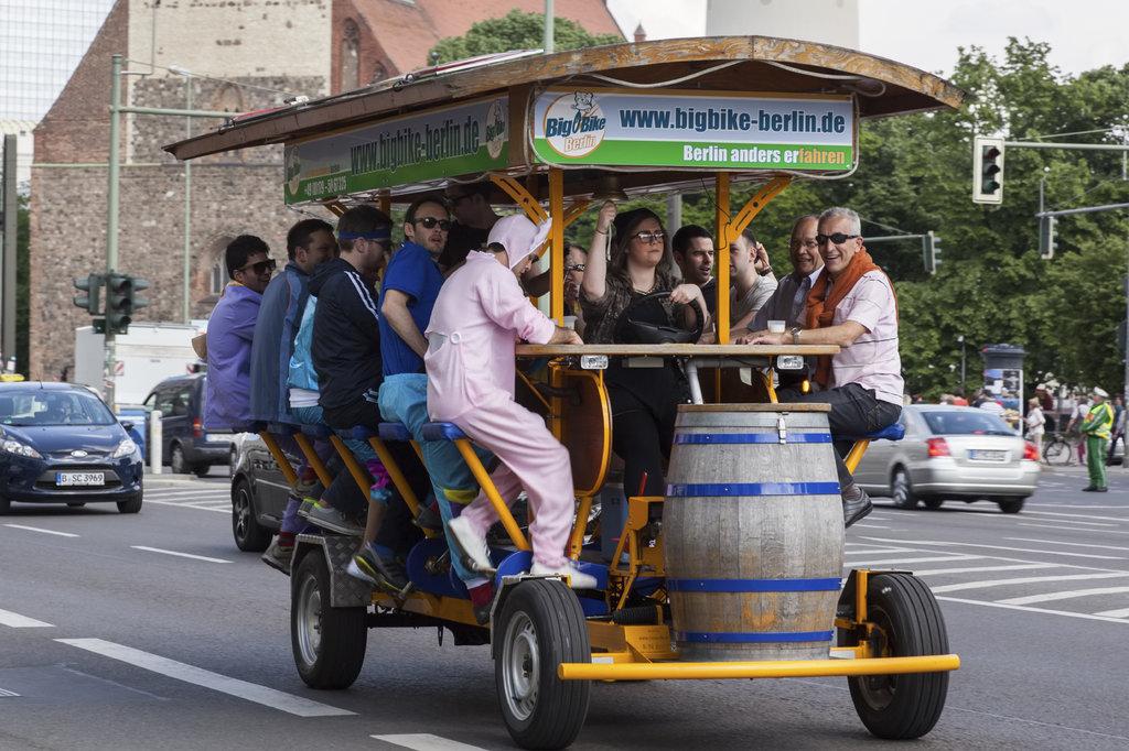 Group of men in Berlin on bicycle bus