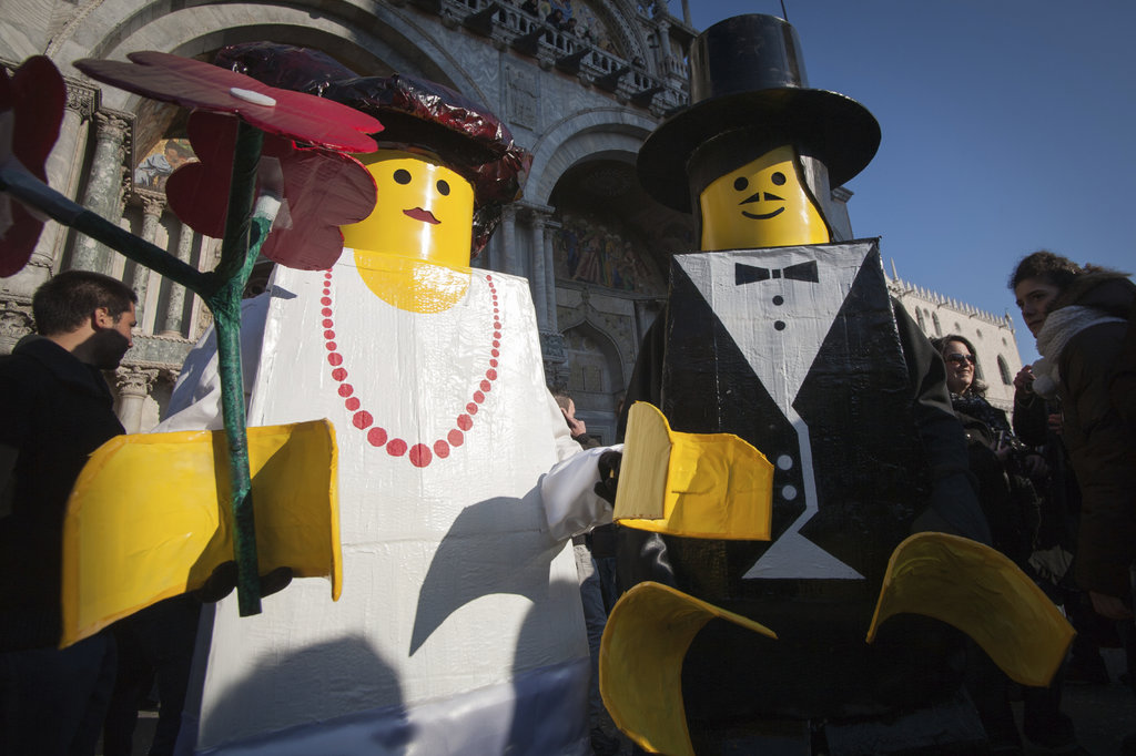 People dressed in Lego costumes