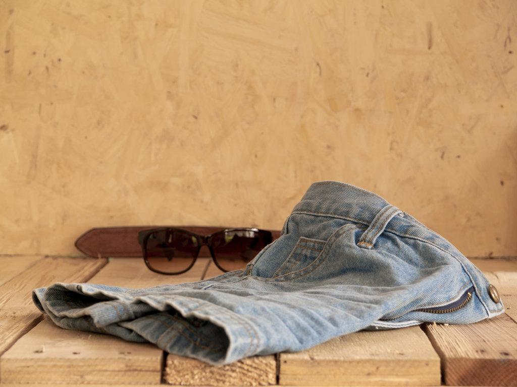 Man tanning in sunglasses