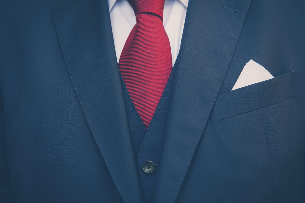 Front of man's suit with pink tie
