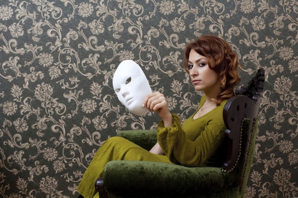Woman sat on chair with mask