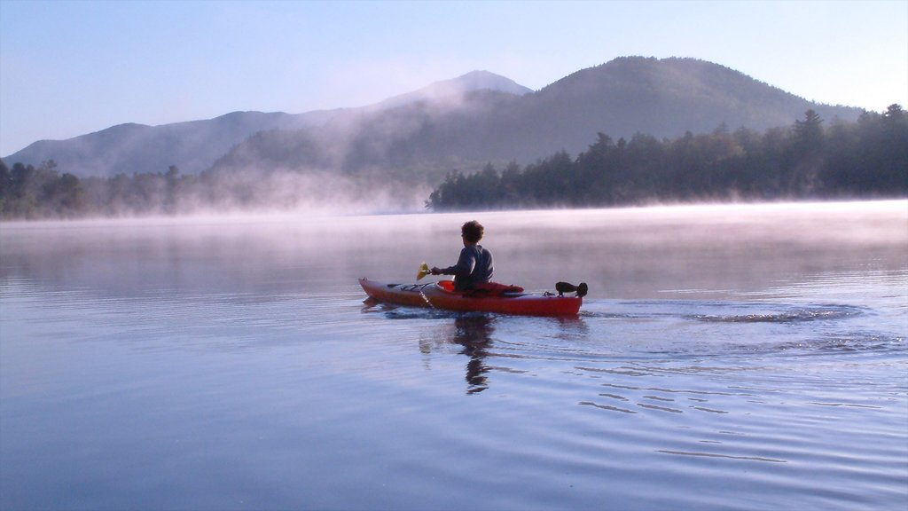 Lake Placid which includes mist or fog, a lake or waterhole and kayaking or canoeing