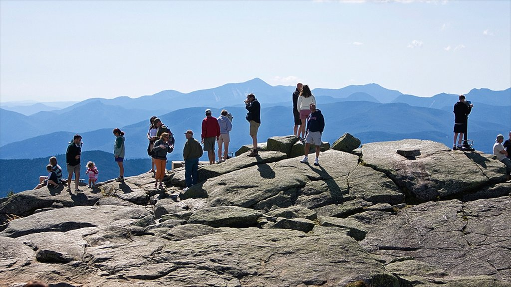 Lake Placid which includes mountains as well as a large group of people