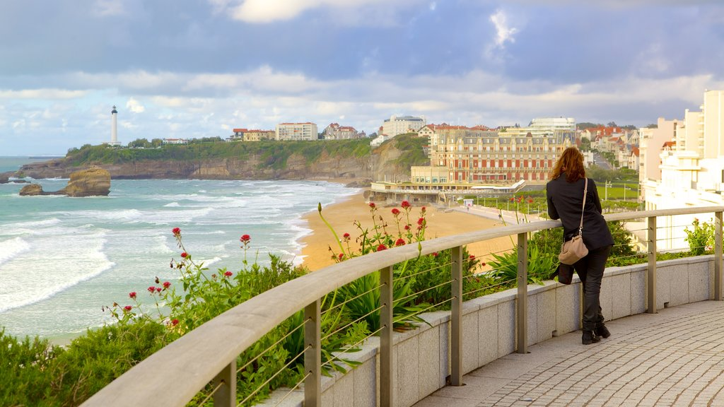 Biarritz which includes views and a coastal town as well as an individual femail