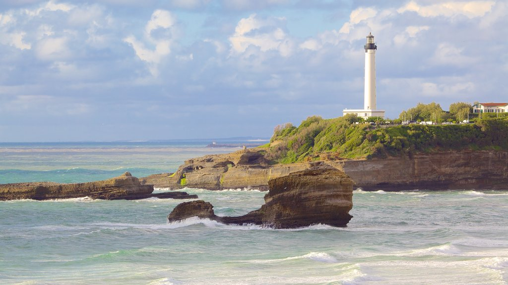 Biarritz showing rugged coastline and a lighthouse