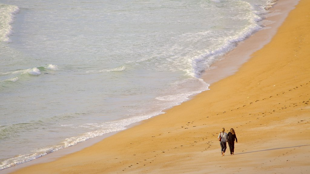 Biarritz which includes hiking or walking and a beach as well as a couple
