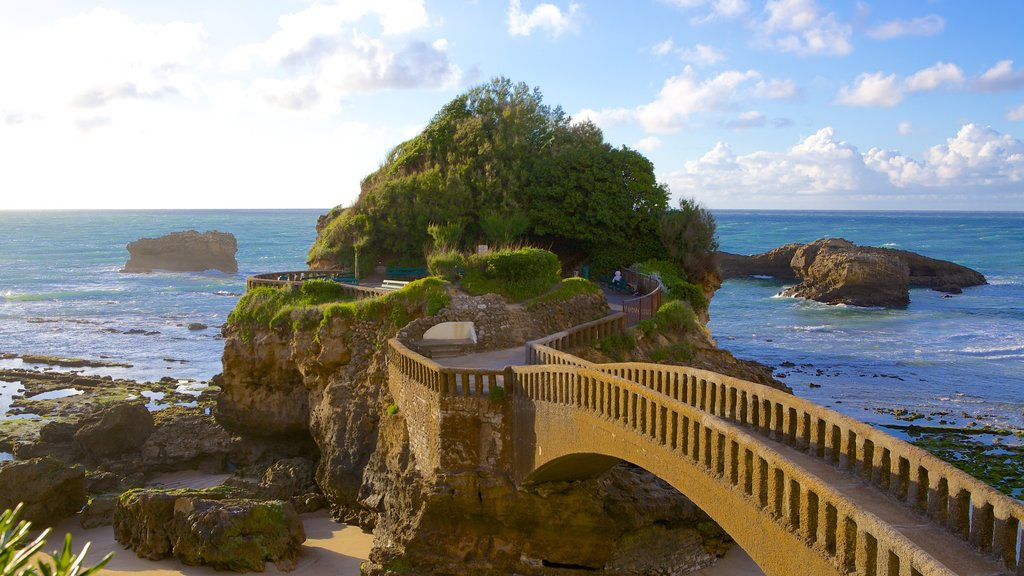 Biarritz which includes a bridge, heritage architecture and rugged coastline