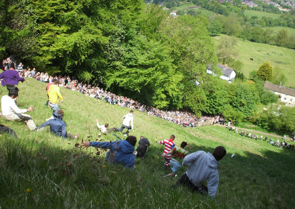 The cheese-rolling gets underway at Cooper's Hill. Photo credit: Dave Farrance.
