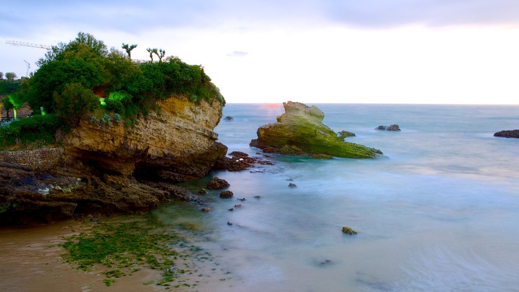Biarritz City Centre which includes a sunset, rocky coastline and general coastal views