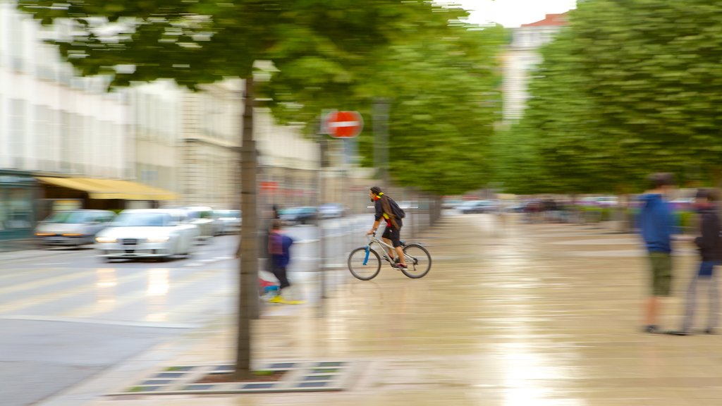 Bellecour Square showing cycling as well as an individual male