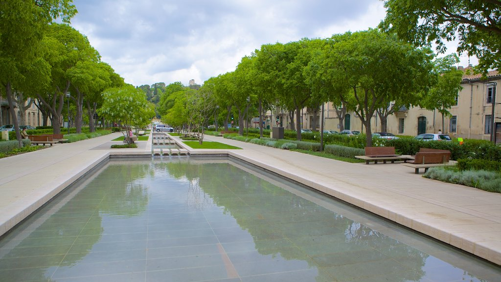 Nimes featuring a pond and a square or plaza