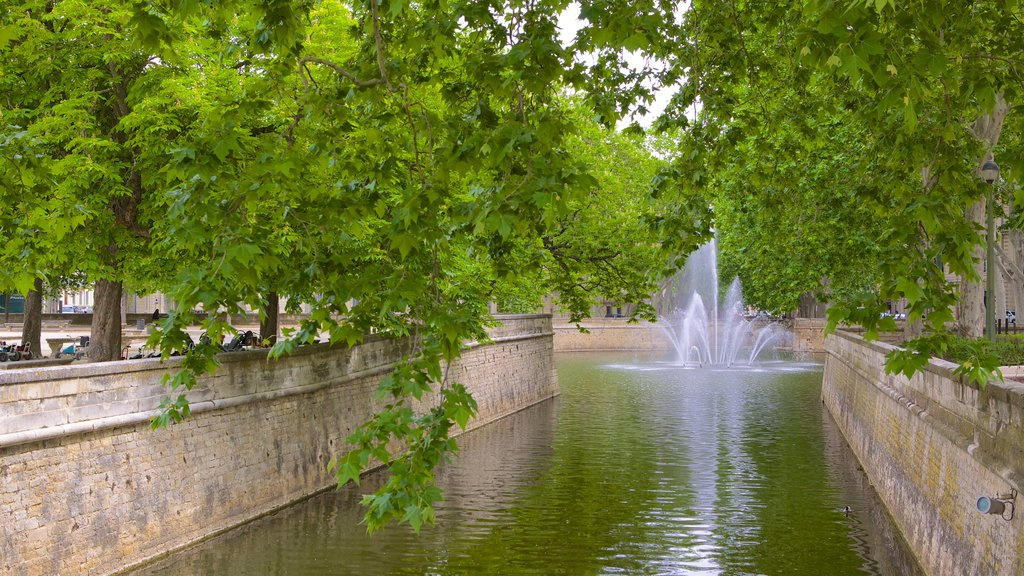 Nimes which includes a river or creek and a fountain
