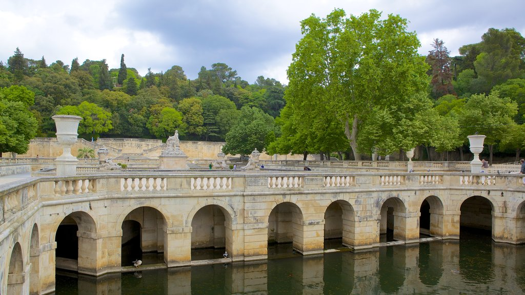 Nimes featuring a river or creek and a bridge