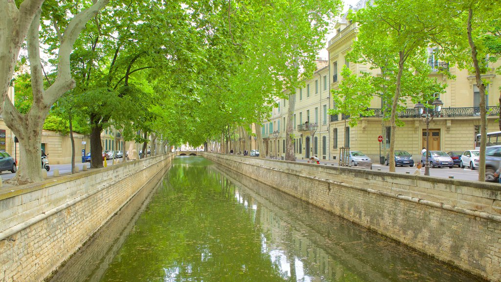 Nimes which includes a river or creek and street scenes