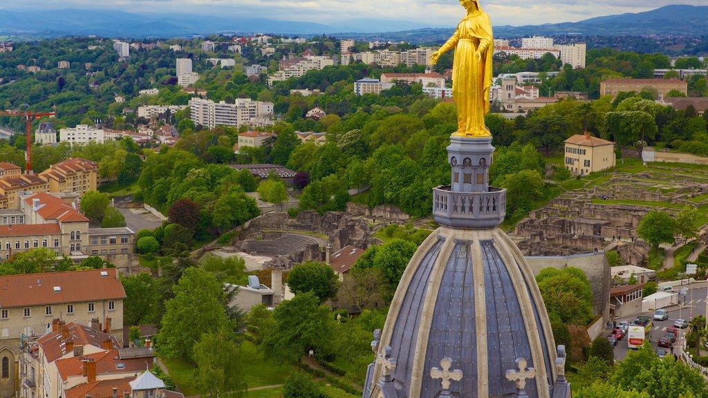 Notre Dame Basilica showing landscape views, a city and a statue or sculpture