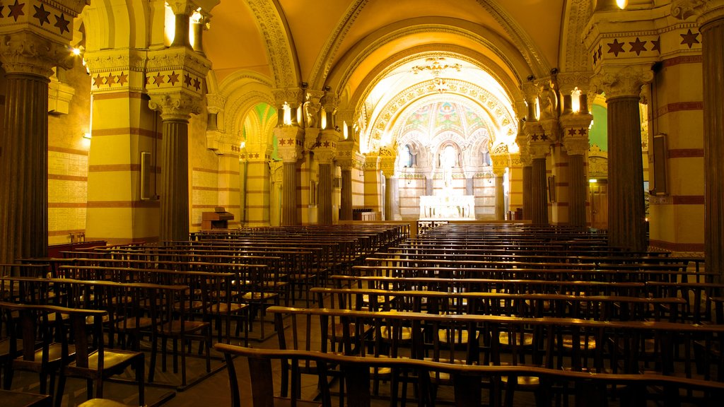 Notre Dame Basilica featuring a church or cathedral, religious elements and interior views