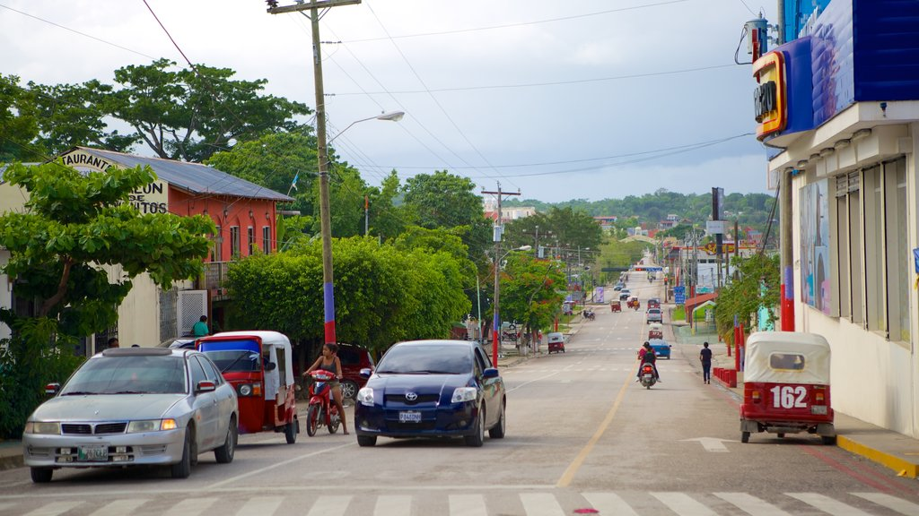 Flores which includes motorbike riding and street scenes