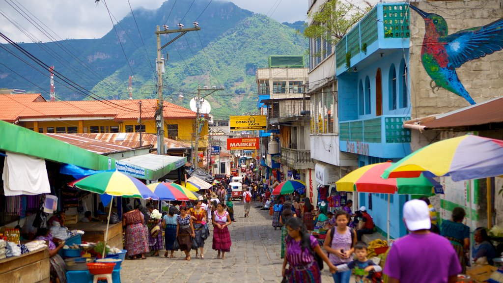 San Pedro La Laguna showing markets and street scenes as well as a large group of people