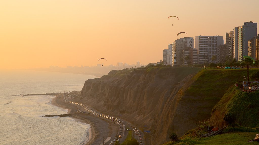 Lima showing a sunset, a city and general coastal views