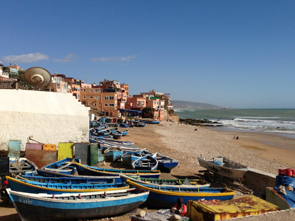 Blue fishing boats on Town Beach in Taghazout, Morocco