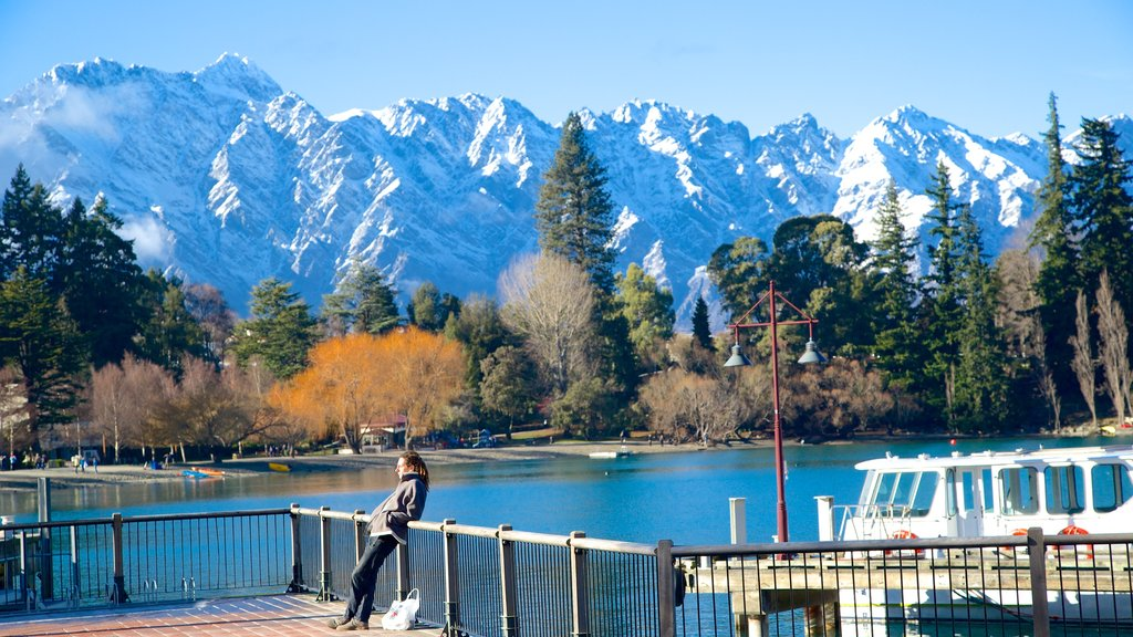 Queenstown which includes a lake or waterhole, mountains and snow