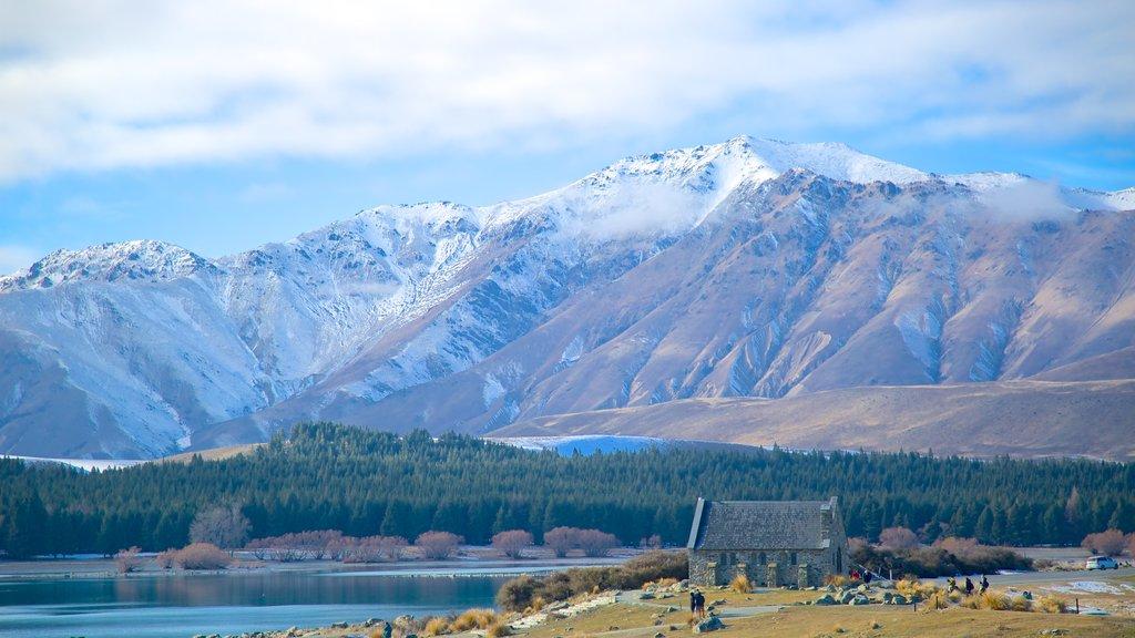 Church of the Good Shepherd ofreciendo un lago o abrevadero, nieve y vistas de paisajes