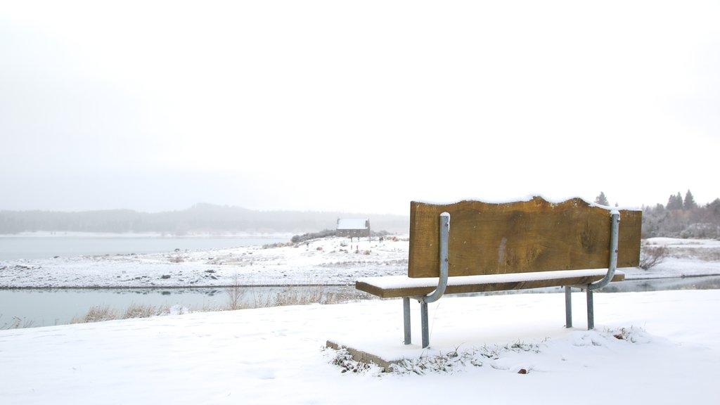 Lake Tekapo featuring a lake or waterhole, snow and landscape views