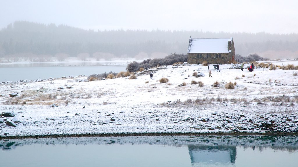 Church of the Good Shepherd featuring a lake or waterhole, landscape views and snow