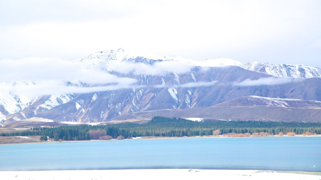 Tekapo Springs which includes a lake or waterhole, snow and mountains