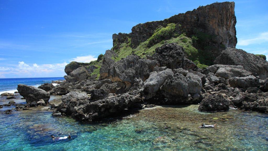 Saipan which includes landscape views and rocky coastline