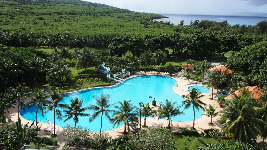 Saipan showing a pool, landscape views and a luxury hotel or resort