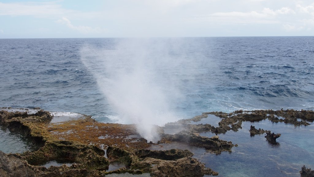 Saipan which includes rugged coastline